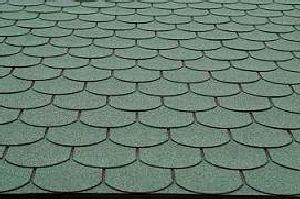green asphalt roof shingles